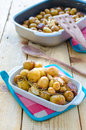 A tray of roasted new potatoes Stock Photos