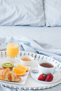 Tray with tasty breakfast on a bed Stock Images