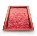 Tray with water red color and dripping effect clipping path on Royalty Free Stock Photo