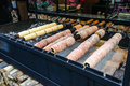 Trdelnik, traditional dessert baked in an open fire wooden stake in Prague Christmas Market. Royalty Free Stock Photo