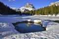 The tre cime of lavaredo a beautiful and scenic view seen from a frozen lake Royalty Free Stock Image