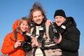 Tre fotographers contro cielo blu 2 Immagini Stock