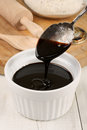 Treacle black or molasses selective focus on the spoon Stock Photo
