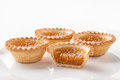 Treacle tarts on a white plate ideal for cut out four one cut in half Royalty Free Stock Photos