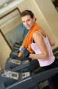Treadmill Woman with Orange Towel Stock Images