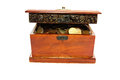Treasure chest box with coins from all over the world Stock Photo