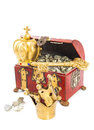 Treasure chest filled with golden objects isolated over white Royalty Free Stock Photo