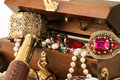 Treasure chest pirate with pearls jewels coins and glass Stock Photography