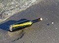 Treasure map in the bottle on the shore of the ocean glass Royalty Free Stock Image