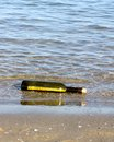 Treasure map in the bottle on the shore of the ocean glass Stock Photos