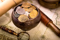 Treasure pot on old map background Royalty Free Stock Photography