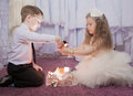 Treasures elegant girl and the boy look gifts Royalty Free Stock Images