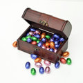 Treasury trunk chocolate candy easter eggs white Stock Photo