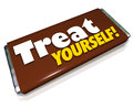 Treat yourself chocolate candy bar indulgence the words on a wrapper to illustrate and treating your hunger or appetite to a Royalty Free Stock Photos