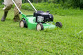 Treatment of grass with the mower. Royalty Free Stock Photo
