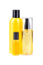 Treatments for bodycare lotions in yellow bottles on white background Royalty Free Stock Images