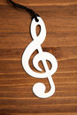 Treble clef on brown wooden background Royalty Free Stock Images