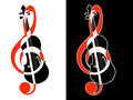 Treble clef and violin on a white and black background Royalty Free Stock Photos