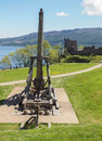 Trebuchet at urquhart castle scotland beautiful view of the on loch ness in on a summers day medieval catapult for attacking Stock Photo
