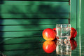 Tree big nectarines and a glass of water on a table creative nutrition concept Royalty Free Stock Images