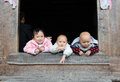 Tree Children life in the poor old village in China Royalty Free Stock Photo