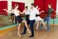 Tree couples dancing rock and roll happy european in class Stock Photo