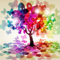 Tree with a crown made of butterflies. Stock Photos