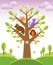 Tree and cute animals bunch of little creatures gathered on the branches of Stock Photos