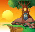 A tree house near the cliff illustration of Stock Photography