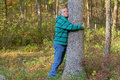 Tree hugger man shown hugging expressing love for nature and environment Stock Photography