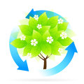 Tree icon with blue arrows and flowers Royalty Free Stock Images