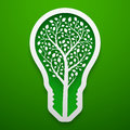 Tree within lightbulb shape. Paper art for the Earth Day decoration. Vector illustration of ecological idea. Concept design