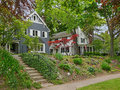 Tree lined neighborhood of middle class suburban houses Royalty Free Stock Photo