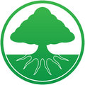 Tree logo with root system visible under ground Royalty Free Stock Photo