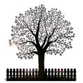 Tree silhouette with leaves and garden fence Royalty Free Stock Photo
