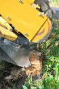 Tree stump machine removal in use outdoors Royalty Free Stock Photography
