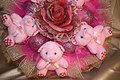 Tree teddy bears in the original composition of pink color with a cloth and artificially flower new year s with Royalty Free Stock Images