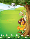 A tree at the top of the hills with animals hiding illustration Royalty Free Stock Image