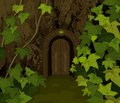 Tree trunk gates to magic elves castle Royalty Free Stock Photo