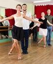 Tree young couples dancing waltz beautiful in class Stock Photo