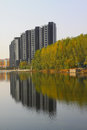 Trees and high rise building by the lake in a park north china Stock Images