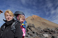 Trekker with a child at pico del teide mother and baby daughter trekking below summit the volcano in tenerife canary islands Royalty Free Stock Image
