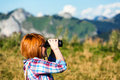 Trekker using binoculars woman in french alps lapdscape Stock Photos