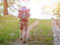 Trekker walking on a mountain path during sunset Stock Photo