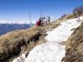 Trekking backpack montelema ticino switzerland resting on the ground with snow last season Stock Photo