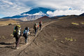 Trekking on kamchatka hikers moving volcano land in russia Royalty Free Stock Photo
