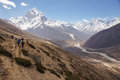 Trekking to everest a group along the side of a mountain on the way Royalty Free Stock Images