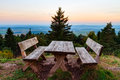 Trekking trail frankenweg with benches and table in the franconian swiss in bavaria germany warm september evening after sunset Royalty Free Stock Photos