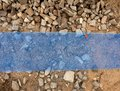 Trench with blue plastic protection tape. Marked of  cables under clay during building of  internet Royalty Free Stock Photo
