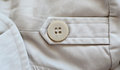Trench coat detail with button Stock Photo